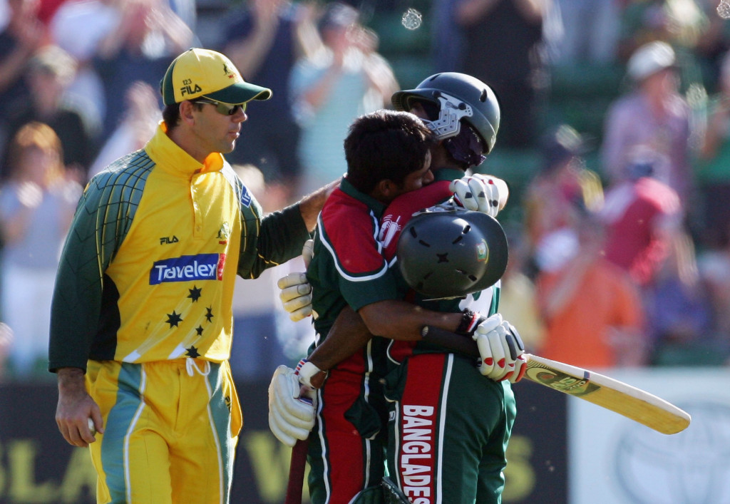 CARDIFF, UNITED KINGDOM - JUNE 18: Mohammad Ashraful (centre) of Bangladesh hugs team mate Aftab Ahmed Chowdhury while he is congratulated on his century by Ricky Ponting of Australia during the NatWest Series One Day International between Australia and Bangladesh played at Sophia Gardens on June 18, 2005 in Cardiff, United Kingdom (Photo by Hamish Blair/Getty Images)