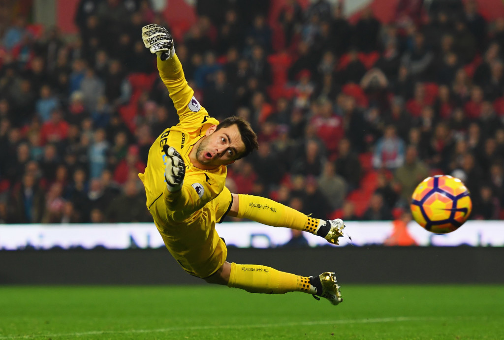 STOKE ON TRENT, ENGLAND - OCTOBER 31: Lukasz Fabianski of Swansea City dives for the ball as a shot by Charlie Adam of Stoke City hits the post during the Premier League match between Stoke City and Swansea City at Bet365 Stadium on October 31, 2016 in Stoke on Trent, England. (Photo by Laurence Griffiths/Getty Images)