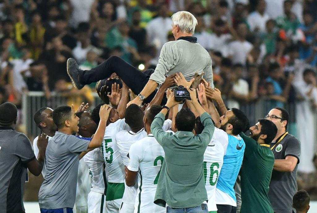 Saudi players carry Bert van Marwijk as they celebrate World Cup qualification.