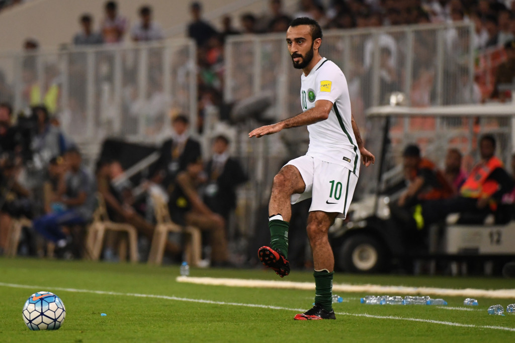 Mohammed Al Sahlawi in action for Saudi Arabia.