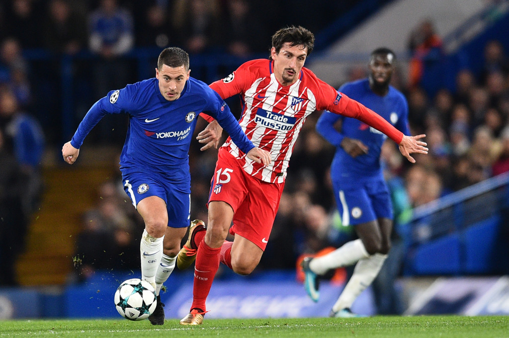 Chelsea's Belgian midfielder Eden Hazard (L) vies with Atletico Madrid's Montenegrin defender Stefan Savic during a UEFA Champions League Group C football match between Chelsea and Atletico Madrid at Stamford Bridge in London on December 5, 2017. / AFP PHOTO / Glyn KIRK (Photo credit should read GLYN KIRK/AFP/Getty Images)