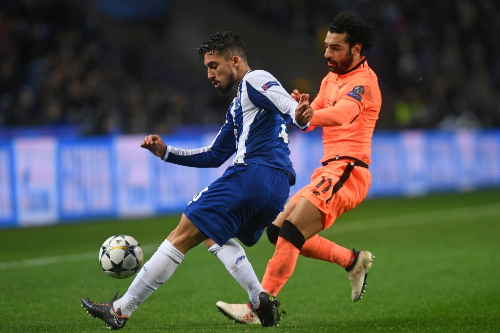 Porto's Brazilian defender Alex Telles (L) vies with Liverpool's Egyptian midfielder Mohamed Salah during the UEFA Champions League round of sixteen first leg football match between FC Porto and Liverpool at the Dragao stadium in Porto, Portugal on February 14, 2018. Liverpool won the game 5-0. / AFP PHOTO / Francisco LEONG (Photo credit should read FRANCISCO LEONG/AFP/Getty Images)