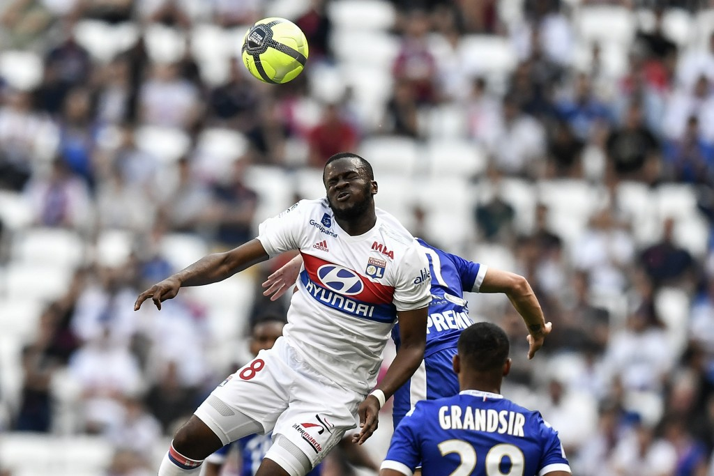 Lyon's French midfielder Tanguy NDombele (L) vies with Troyes' French midfielder Remi Walter (behind) during the French L1 football match Olympique Lyonnais (OL) vs ESTAC Troyes on May 6, 2018, at the Parc Olympique Lyonnais stadium in Decines-Charpieu, central-eastern France. (Photo by JEFF PACHOUD / AFP)        (Photo credit should read JEFF PACHOUD/AFP/Getty Images)