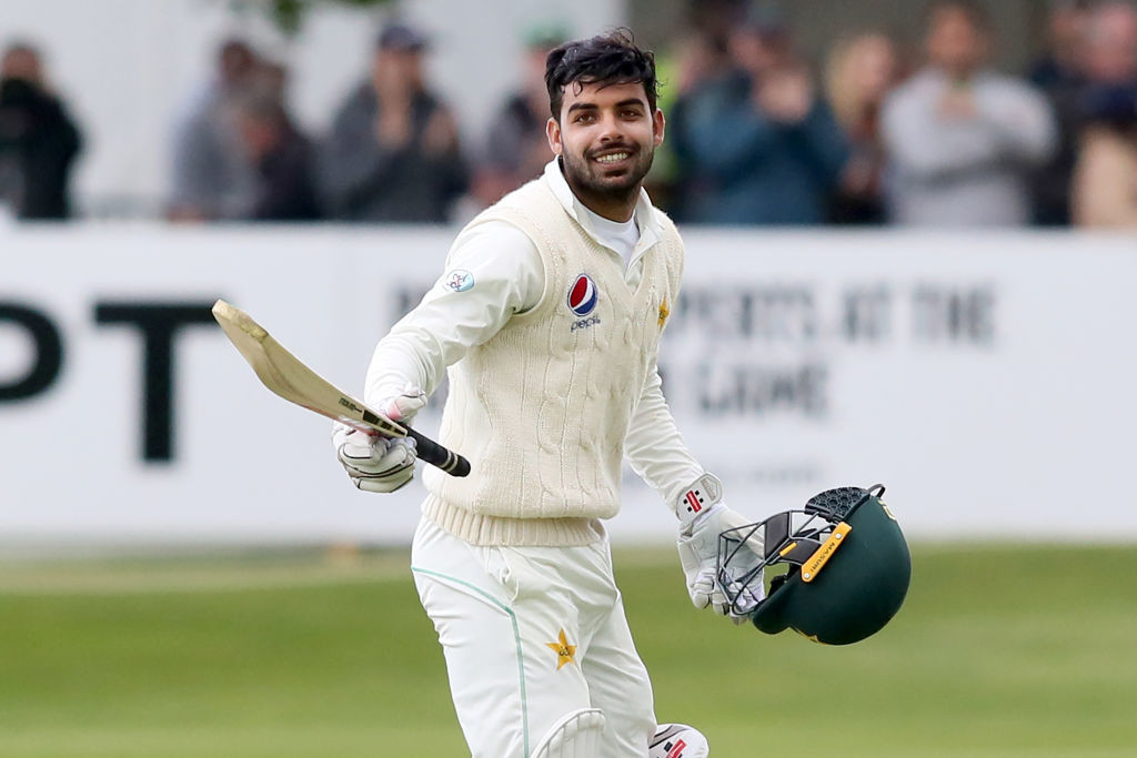 Shadab raises his bat after his half-century against Ireland.