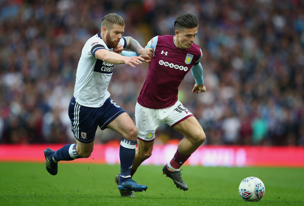 BIRMINGHAM, ENGLAND - MAY 15: Jack Grealish of Aston Villa is tackled by Adam Clayton of Middlesbrough during the Sky Bet Championship Play Off Semi Final:Second Leg match between Aston Villa and Middlesbrough at Villa Park on May 15, 2018 in Birmingham, England. (Photo by Clive Mason/Getty Images)