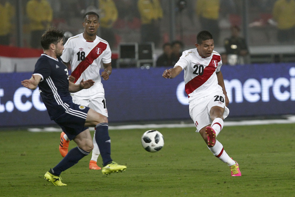 Edison Flores of Peru takes a shot against Scotland.