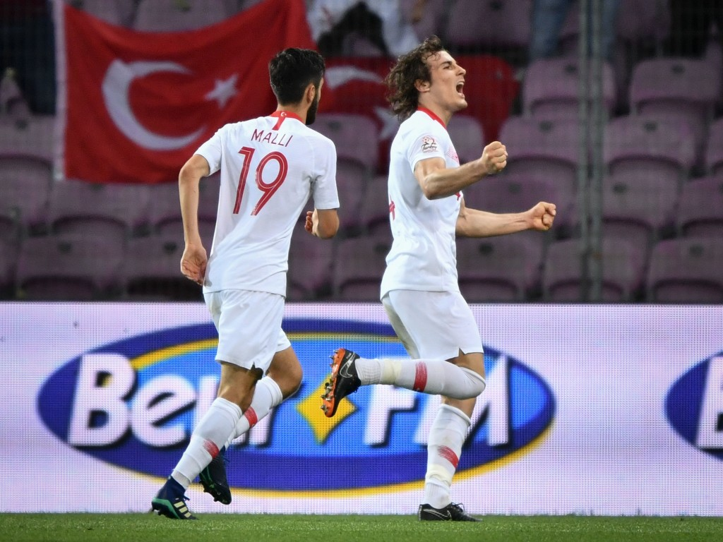 Turkey's defender Caglar Soyuncu (R) celebrates after scoring his team's second goal during the friendly football match between Tunisia and Turkey at the Stade de Geneve stadium in Geneva on June 1, 2018. (Photo by Fabrice COFFRINI / AFP) (Photo credit should read FABRICE COFFRINI/AFP/Getty Images)