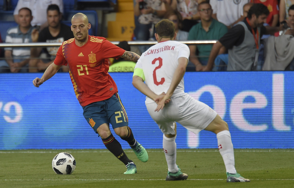 Spain's midfielder David Silva (L) vies with Switzerland's defender Stephan Lichtsteiner during the international friendly football match between Spain and Switzerland at La Ceramica stadium in Vila-real on June 3, 2018. (Photo by JOSE JORDAN / AFP)        (Photo credit should read JOSE JORDAN/AFP/Getty Images)