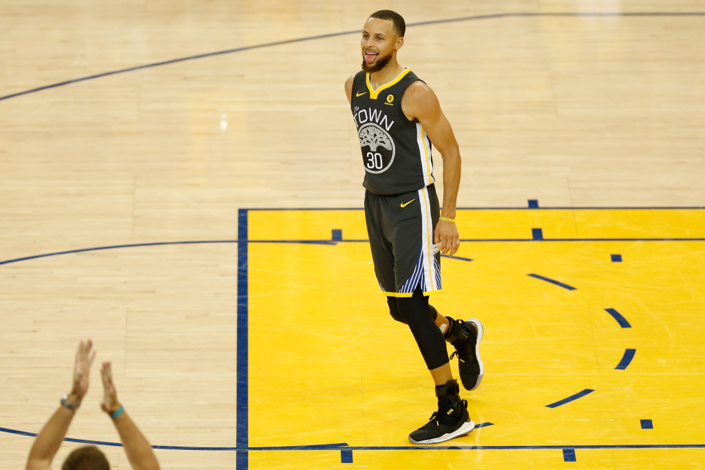 OAKLAND, CA - JUNE 03: Stephen Curry #30 of the Golden State Warriors reacts against the Cleveland Cavaliers during the fourth quarter in Game 2 of the 2018 NBA Finals at ORACLE Arena on June 3, 2018 in Oakland, California. NOTE TO USER: User expressly acknowledges and agrees that, by downloading and or using this photograph, User is consenting to the terms and conditions of the Getty Images License Agreement. (Photo by Lachlan Cunningham/Getty Images)