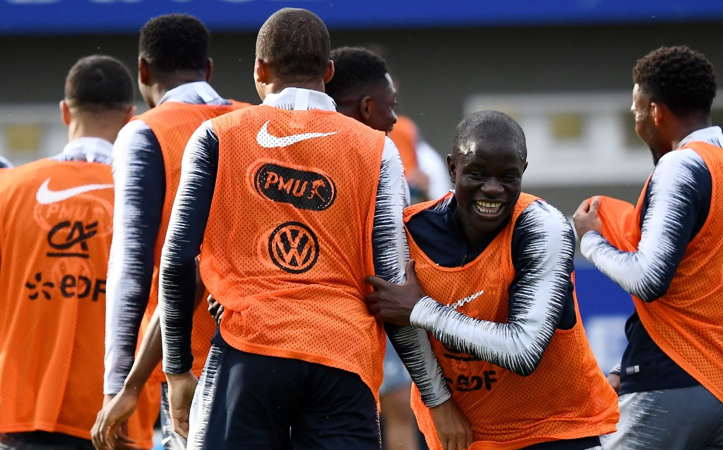 France's midfielder N'Golo Kante (R) reacts during a training session in Clairefontaine-en-Yvelines on June 4, 2018, as part of the team's preparation for the upcoming FIFA World Cup 2018 in Russia. (Photo by FRANCK FIFE / AFP) (Photo credit should read FRANCK FIFE/AFP/Getty Images)