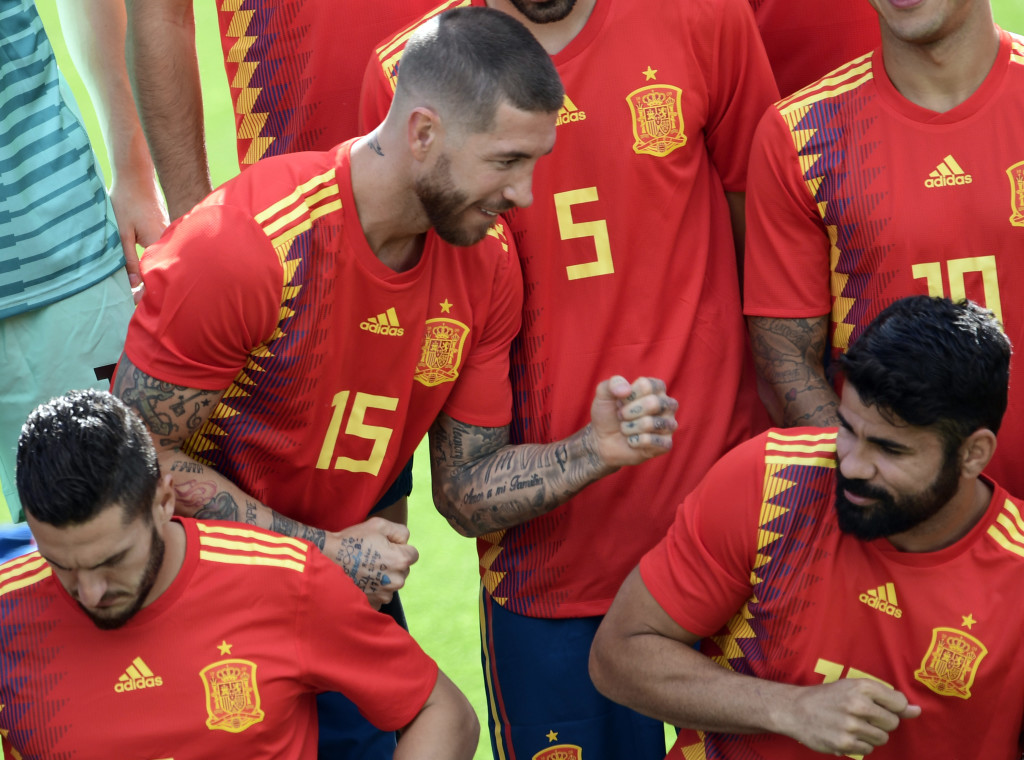 Spain's defender Sergio Ramos (TOP) jokes with Spain's forward Diego Costa (R) as they pose for the squad official photo before a training session at Las Rozas de Madrid sports city on June 5, 2018. (Photo by JAVIER SORIANO / AFP) (Photo credit should read JAVIER SORIANO/AFP/Getty Images)