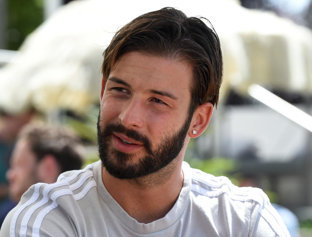 Germany's defender Marvin Plattenhardt speaks with journalists during a so-called media day in the team hotel on June 5, 2018 in Girlan, near Bolzano, northern Italy, ahead of the FIFA World Cup 2018 in Russia. (Photo by Christof STACHE / AFP) (Photo credit should read CHRISTOF STACHE/AFP/Getty Images)