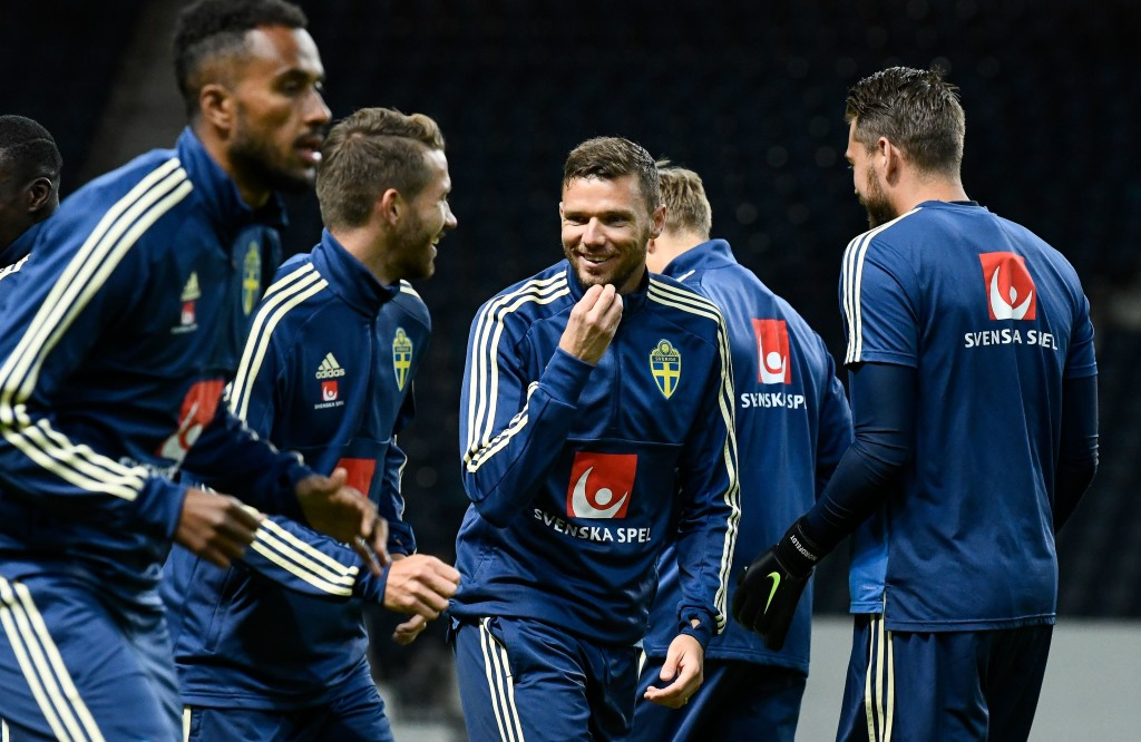 Sweden's forward Marcus Berg (c) reacts during a training session for Sweden.