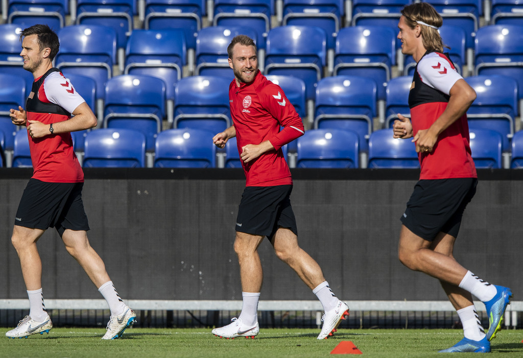 Denmark's midfielder Christian Eriksen (C) and teammates jog during a training session of the Danish national football team at Broendby Stadium in Brondby, Denmark on June 8, 2018, on the eve of the international friendly football match between Denmark and Mexico. (Photo by Anders Kjaerbye / Ritzau Scanpix / AFP) / Denmark OUT (Photo credit should read ANDERS KJAERBYE/AFP/Getty Images)