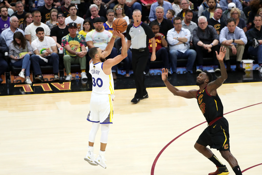 CLEVELAND,OH - Stephen Curry #30 of the Golden State Warriors shoots a 3-pointer against the Cleveland Cavaliers in Game Four of the 2018 NBA Finals on June 8, 2018 at Quicken Loans Arena in Cleveland, Ohio. NOTE TO USER: User expressly acknowledges and agrees that, by downloading and/or using this photograph, user is consenting to the terms and conditions of the Getty Images License Agreement. Mandatory Copyright Notice: Copyright 2018 NBAE (Photo by Joe Murphy/NBAE via Getty Images)
