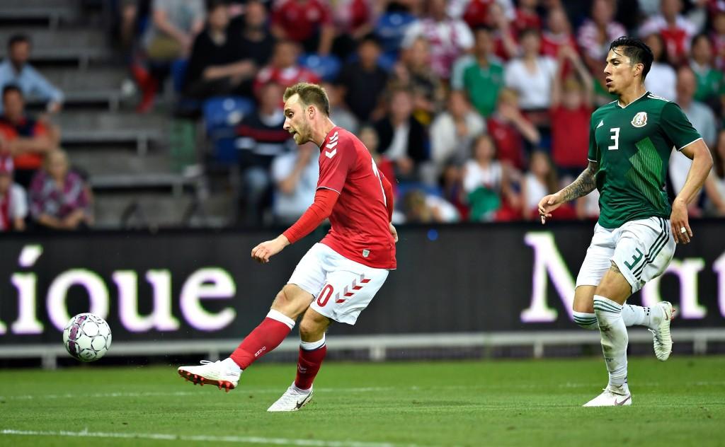 Denmark's Christian Eriksen (l) scores against Mexico.