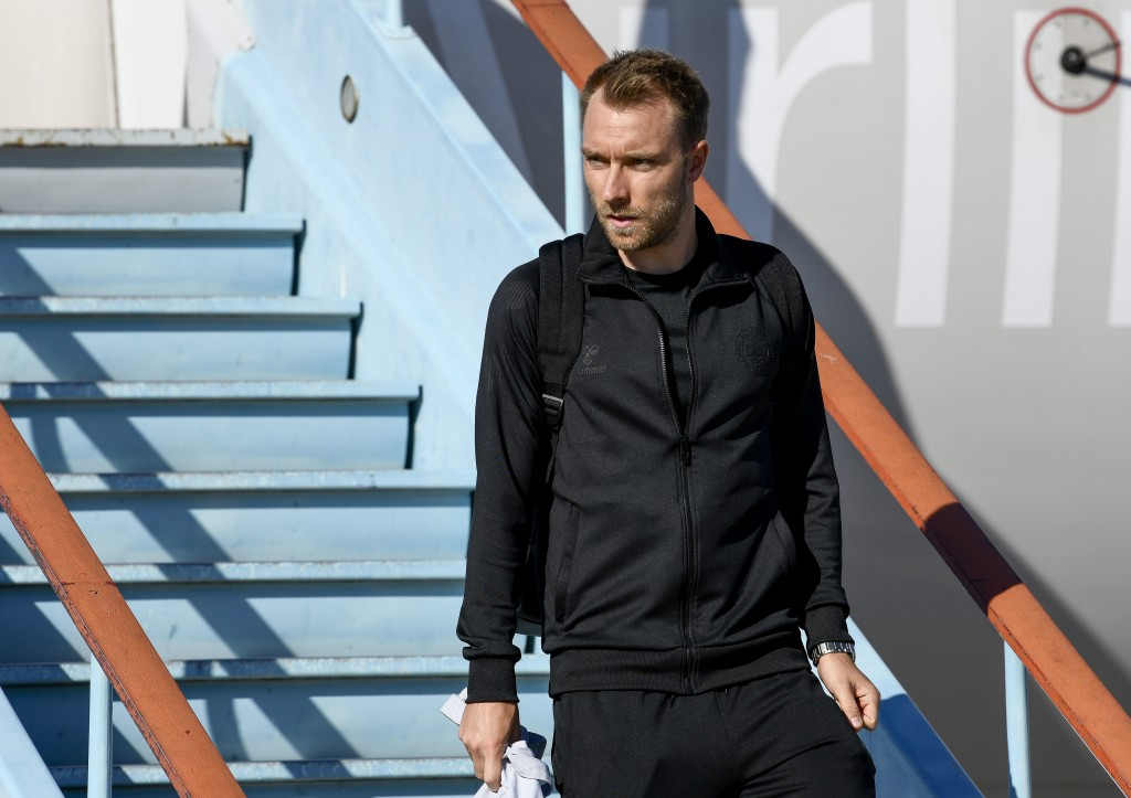 Denmark's midfielder Christian Eriksen disembarks from a plane at Anapa airport near Vityazevo.