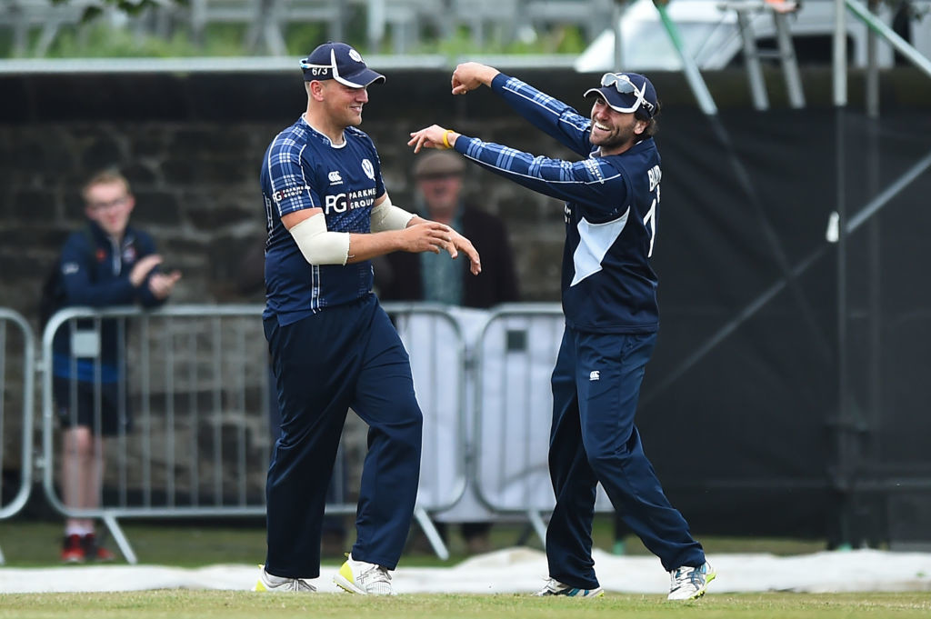 Watt and Budge celebrate after combining for an excellent catch.