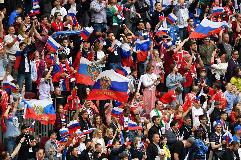 Russia's supporters wave national flags during the Russia 2018 World Cup Group A football match between Russia and Saudi Arabia at the Luzhniki Stadium in Moscow on June 14, 2018. (Photo by Mladen ANTONOV / AFP) / RESTRICTED TO EDITORIAL USE - NO MOBILE PUSH ALERTS/DOWNLOADS (Photo credit should read MLADEN ANTONOV/AFP/Getty Images)