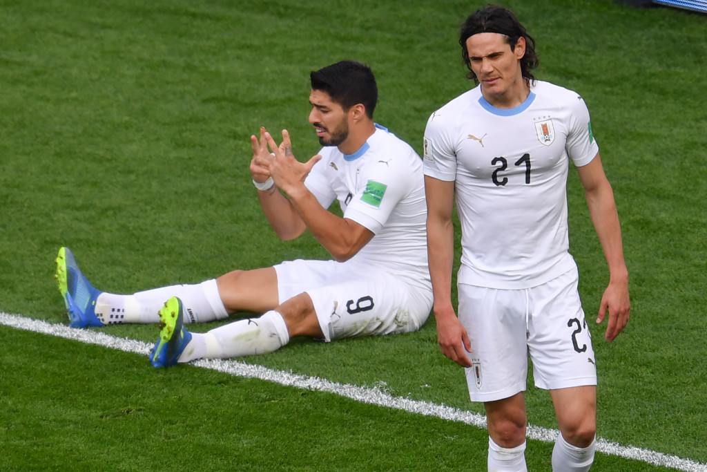 Luis Suarez (l) reacts after his missed chance against Egypt.