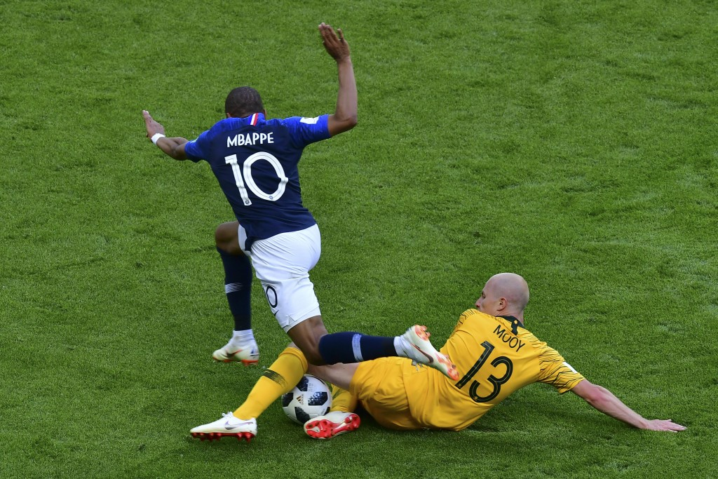 TOPSHOT - Australia's midfielder Aaron Mooy (R) tackles France's forward Kylian Mbappe during the Russia 2018 World Cup Group C football match between France and Australia at the Kazan Arena in Kazan on June 16, 2018. (Photo by Luis Acosta / AFP) / RESTRICTED TO EDITORIAL USE - NO MOBILE PUSH ALERTS/DOWNLOADS (Photo credit should read LUIS ACOSTA/AFP/Getty Images)