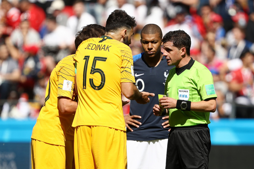 KAZAN, RUSSIA - JUNE 16: Mile Jedinak of Australia confronts referee Andres Cunha after he awards a penalty during the 2018 FIFA World Cup Russia group C match between France and Australia at Kazan Arena on June 16, 2018 in Kazan, Russia. (Photo by Robert Cianflone/Getty Images)