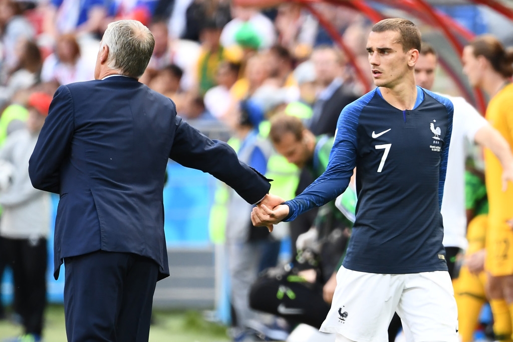 France's coach Didier Deschamps (L) takes France's forward Antoine Griezmann's hand during the Russia 2018 World Cup Group C football match between France and Australia at the Kazan Arena in Kazan on June 16, 2018. (Photo by FRANCK FIFE / AFP) / RESTRICTED TO EDITORIAL USE - NO MOBILE PUSH ALERTS/DOWNLOADS (Photo credit should read FRANCK FIFE/AFP/Getty Images)