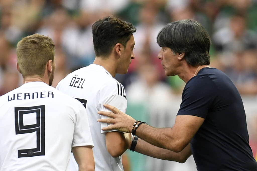 Germany's coach Joachim Loew (R) speaks with Germany's midfielder Mesut Ozil (L) during the Russia 2018 World Cup Group F football match between Germany and Mexico at the Luzhniki Stadium in Moscow on June 17, 2018. (Photo by Patrik STOLLARZ / AFP) / RESTRICTED TO EDITORIAL USE - NO MOBILE PUSH ALERTS/DOWNLOADS (Photo credit should read PATRIK STOLLARZ/AFP/Getty Images)
