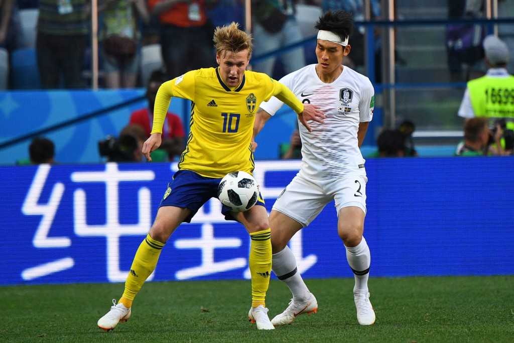 Sweden's midfielder Emil Forsberg (L) vies for the ball with South Korea's defender Lee Yong during the Russia 2018 World Cup Group F football match between Sweden and South Korea at the Nizhny Novgorod Stadium in Nizhny Novgorod on June 18, 2018. (Photo by Johannes EISELE / AFP) / RESTRICTED TO EDITORIAL USE - NO MOBILE PUSH ALERTS/DOWNLOADS (Photo credit should read JOHANNES EISELE/AFP/Getty Images)