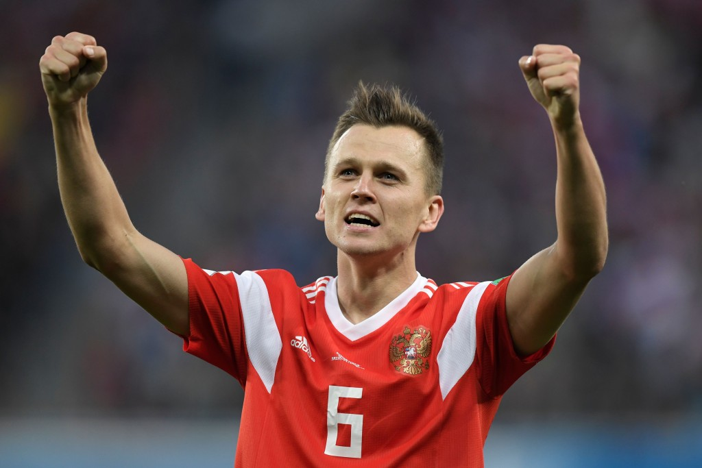 TOPSHOT - Russia's midfielder Denis Cheryshev celebrates scoring the 2-0 goal during the Russia 2018 World Cup Group A football match between Russia and Egypt at the Saint Petersburg Stadium in Saint Petersburg on June 19, 2018. (Photo by GABRIEL BOUYS / AFP) / RESTRICTED TO EDITORIAL USE - NO MOBILE PUSH ALERTS/DOWNLOADS (Photo credit should read GABRIEL BOUYS/AFP/Getty Images)