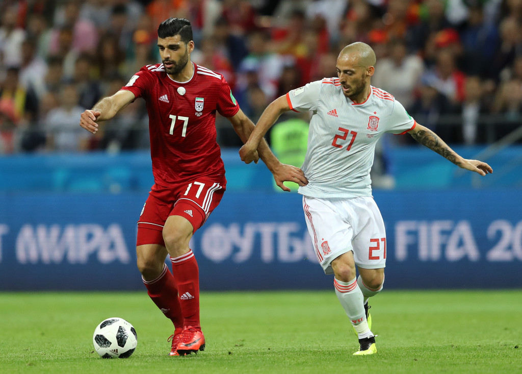 KAZAN, RUSSIA - JUNE 20: Mehdi Taremi of Iran is tackled by David Silva of Spain during the 2018 FIFA World Cup Russia group B match between Iran and Spain at Kazan Arena on June 20, 2018 in Kazan, Russia. (Photo by Richard Heathcote/Getty Images)