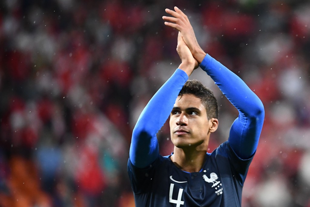 France's defender Raphael Varane applauds at the end of the Russia 2018 World Cup Group C football match between France and Peru at the Ekaterinburg Arena in Ekaterinburg on June 21, 2018. (Photo by FRANCK FIFE / AFP) / RESTRICTED TO EDITORIAL USE - NO MOBILE PUSH ALERTS/DOWNLOADS (Photo credit should read FRANCK FIFE/AFP/Getty Images)