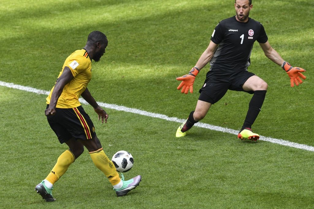 Romelu Lukaku (L) scores his second goal.