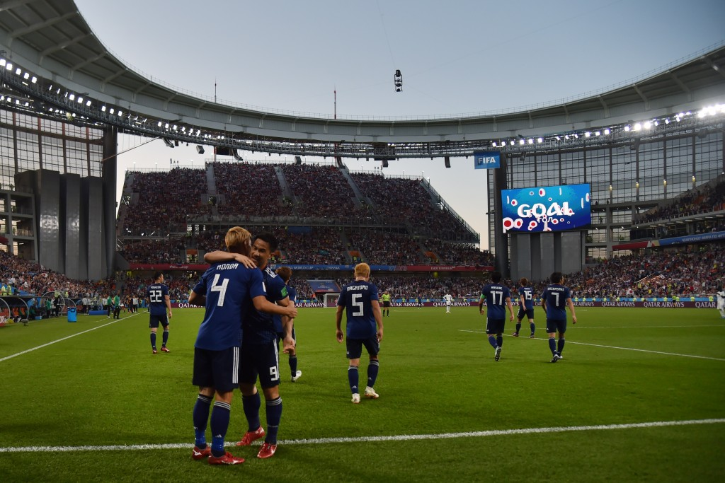 TOPSHOT - Japan's midfielder Keisuke Honda (L) is congratulated by teammates after scoring his team's second goal during the Russia 2018 World Cup Group H football match between Japan and Senegal at the Ekaterinburg Arena in Ekaterinburg on June 24, 2018. (Photo by Hector RETAMAL / AFP) / RESTRICTED TO EDITORIAL USE - NO MOBILE PUSH ALERTS/DOWNLOADS (Photo credit should read HECTOR RETAMAL/AFP/Getty Images)