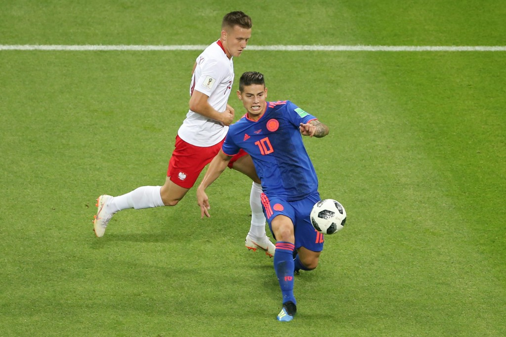 Colombia's midfielder James Rodriguez (R) controls the ball during the Russia 2018 World Cup Group H football match between Poland and Colombia at the Kazan Arena in Kazan on June 24, 2018. (Photo by Roman Kruchinin / AFP) / RESTRICTED TO EDITORIAL USE - NO MOBILE PUSH ALERTS/DOWNLOADS (Photo credit should read ROMAN KRUCHININ/AFP/Getty Images)