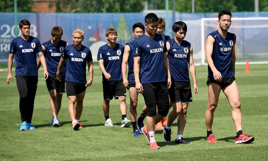 KAZAN, RUSSIA - JUNE 25: Japan players arrive on the pitch during a Japan training session on June 25, 2018 in Kazan, Russia. (Photo by Carl Court/Getty Images)