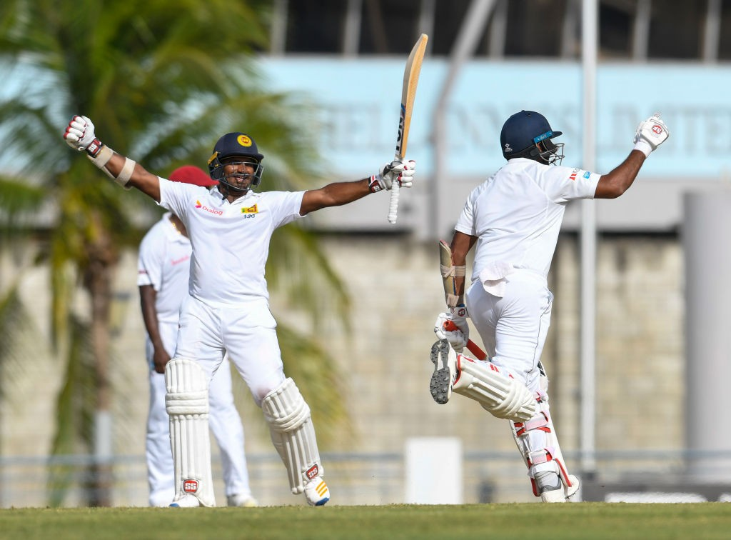 Kusal and Dilruwan Perera celebrate after hitting the winning runs.