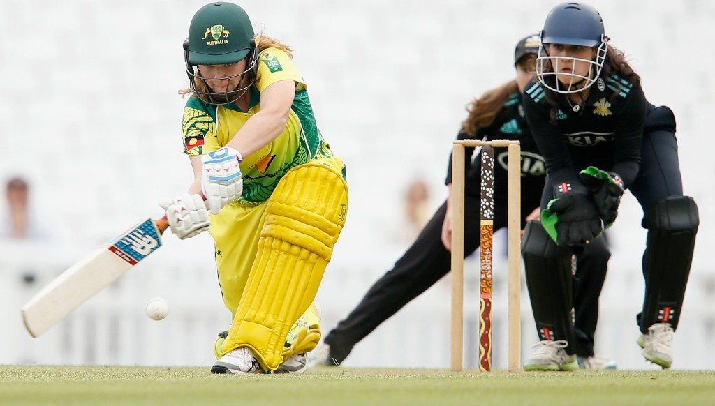 Hannah Darlington from the Women's Aboriginal XI sweeps on her way to 32