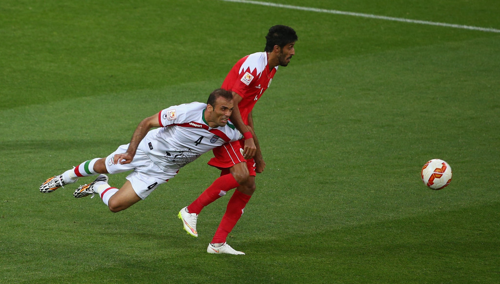 Jalal Hosseini (l) has surprisingly been left out of Iran's World Cup squad.