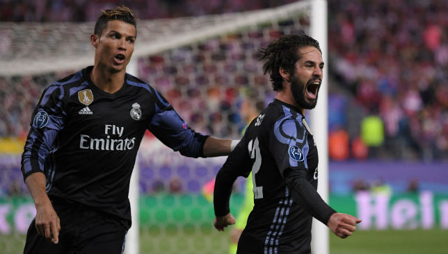 Isco (R) of Real Madrid celebrates scoring his team's opening goal with Cristiano Ronaldo