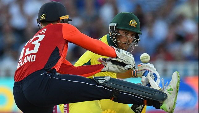 Aaron Finch guides the ball past Jos Buttler.
