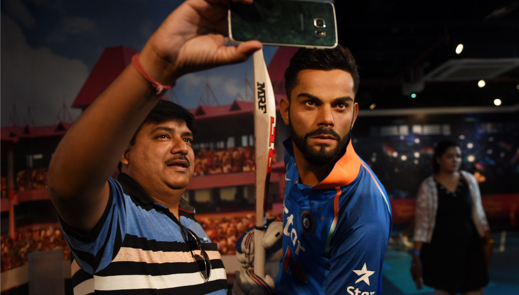 Visitors flocked to take selfies with Kohli's wax statue.