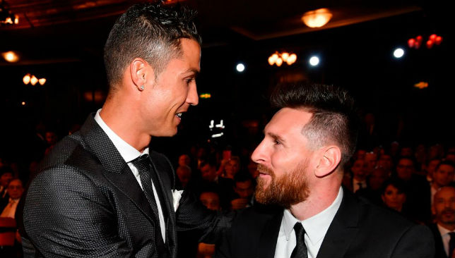 Messi (R) and Real Madrid and Portugal forward Cristiano Ronaldo