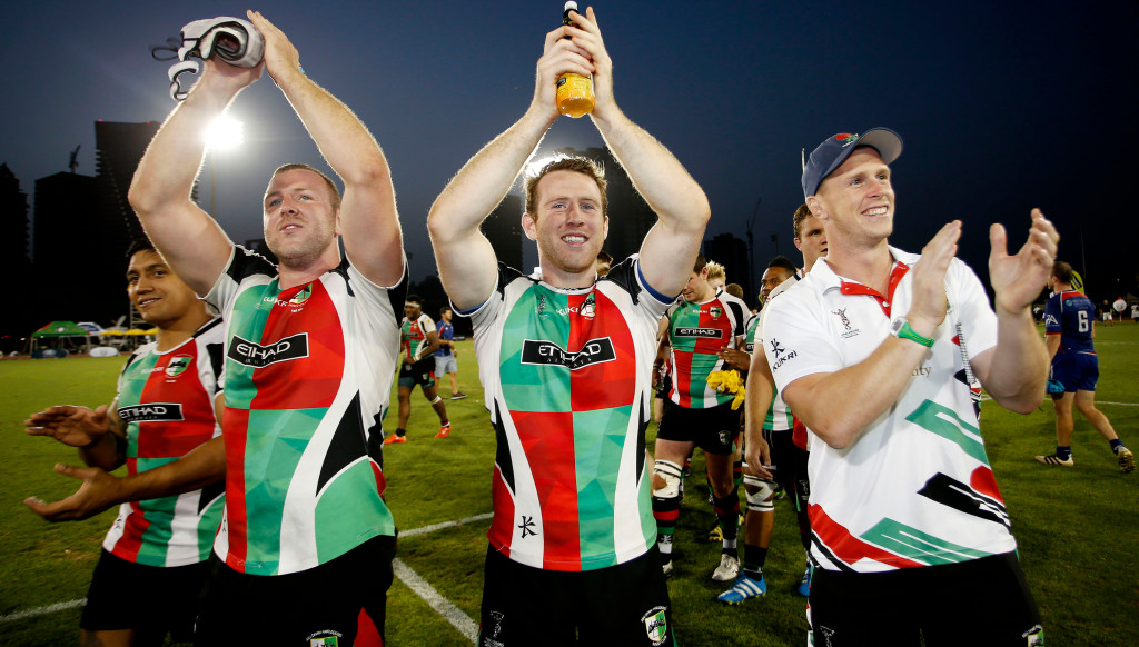 Mike McFarlane (r) celebrates with brothers Sam and Ben Bolger (l) after winning the UAE Premiership, their fifth and final trophy of 2016/17.