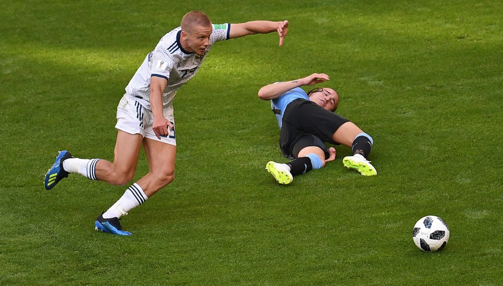 Igor Smolnikov (l) was dismissed for a lunge on Diego Laxalt.