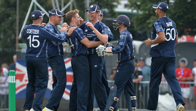 One to remember: Alasdair Evans (fourth left) celebrates with his team-mates