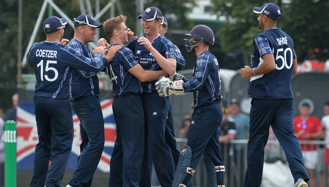 EDINBURGH, SCOTLAND - JUNE 10: Alasdair Evans (L4), and Richie Berrington (L3), of Scotland celebrate taking the wicket of Alex Hales with there team mates during the One Day International match between Scotland and England at The Grange on June 10, 2018 in Edinburgh, Scotland. (Photo by Mark Runnacles/Getty Images)