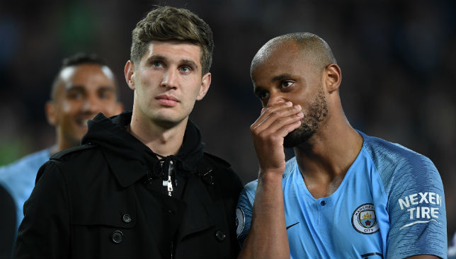 Stones of Manchester City speaks to Vincent Kompany