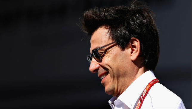 Toto Wolff walks in the Paddock