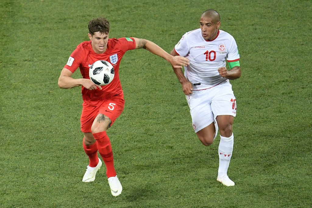 Wahbi Khazri (r) battles hard against John Stones
